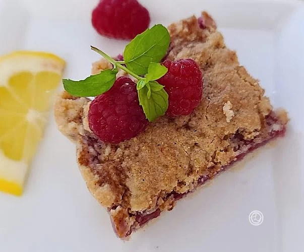 One of the tasty quick and easy Gluten-Free Raspberry Crumb Bars on a plate