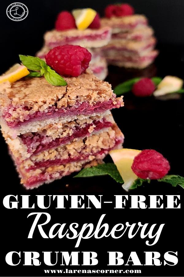 Gluten-Free Raspberry Crumb Bars on a black background with raspberries, lemon slice, and mint.