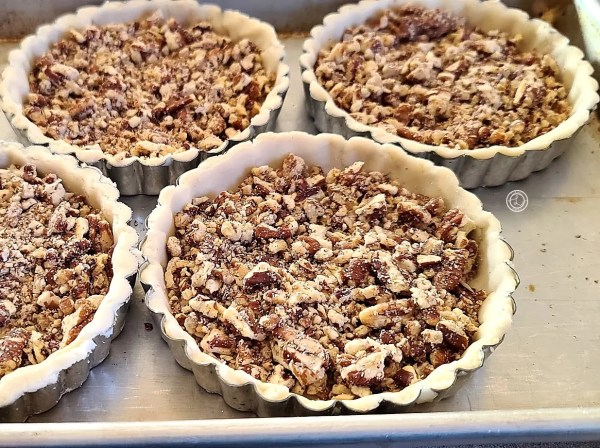 Pecans added to the tart crusts