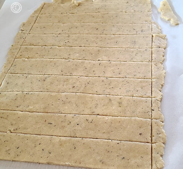 Gluten-Free Italian Garlic Breadsticks cutting them out