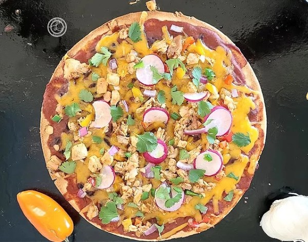 A picture of Gluten-Free Mexican Chicken Pizza on a pizza stone
