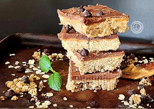 No Bake Peanut Butter Bars stacked on a serving tray
