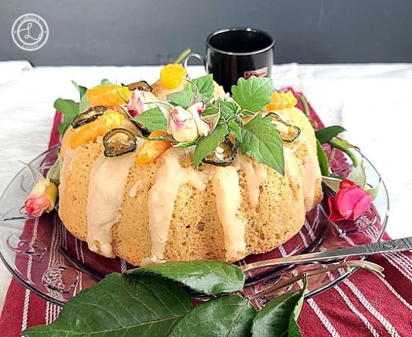 Gluten-Free Jalapeno Marmalade Cake decorated cake with orange slices and candied jalapeno