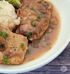 A Plate of Gluten-Free Smothered Pork Chops and rice with parsley