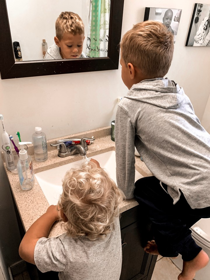 Raising boys means tons of climbing - boy on the sink while brushing teeth