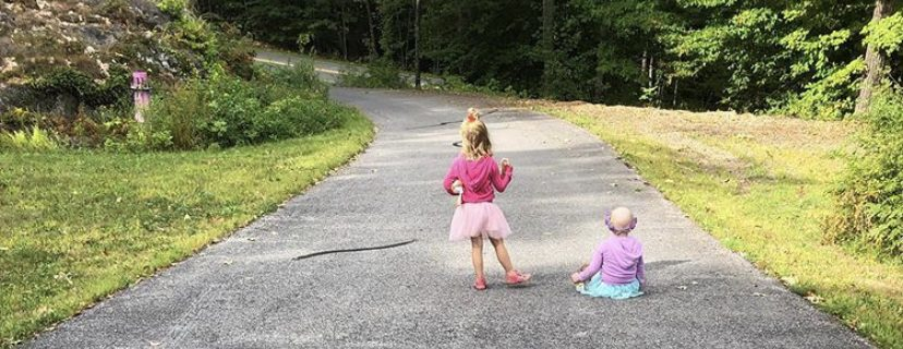 Sisters walking on a road