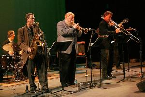HORNS: Joey Sellers (right) and the other musicians turn up the beat. (Claire Cote/Lariat 2009)
