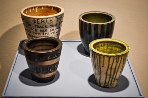 A collection of pots, some displaying messages of Death and sentiments towards Nuclear Power.