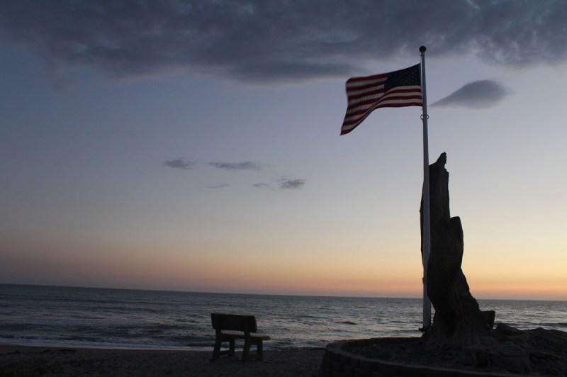The sun sets over the 9/11 memorial at Poche Beach in Capistrano Beach, California. (Photograph: Amarah Hernandez)