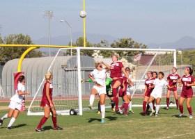 Saddleback College's women's soccer team gather to block goal shot attempt. (Photographer/Anibal Santos)