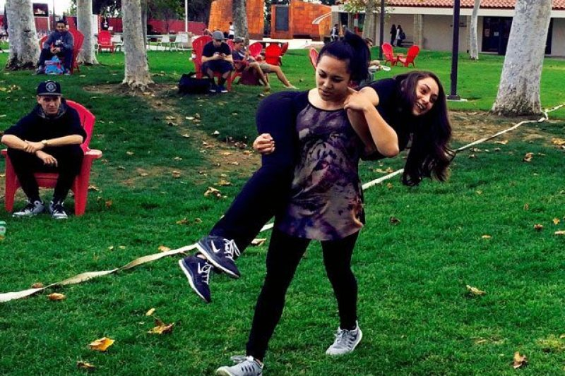 "Saddleback student, Margarette Long carries Sahar Obid during CFT's ""Maneuver under fire."""