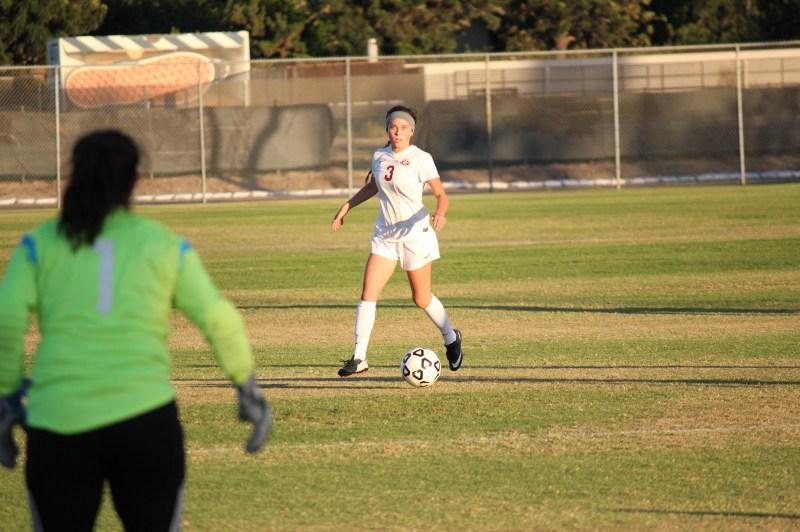 Saddleback College women's soccer team No.3, Devin Scelsi freshman, midfielder, take shot at goal (Photographs/Dominic
