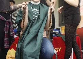 One Saddleback College student chops off her braids for the St. Baldrick's Foundation. Elizabeth Ortiz/ Lariat.