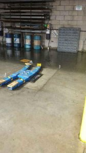 Water rises from below the auto lifts in Auto Tech. (Photo Credit: Auto Tech Students)