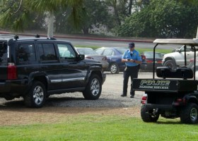 A Saddleback College police officer writes a parking ticket for a Jeep parked illegally. (Niko LaBarbera)