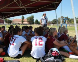 Head Coach BJ McNicol prepares the team during a group meeting. (Dominic Ebel/Lariat)