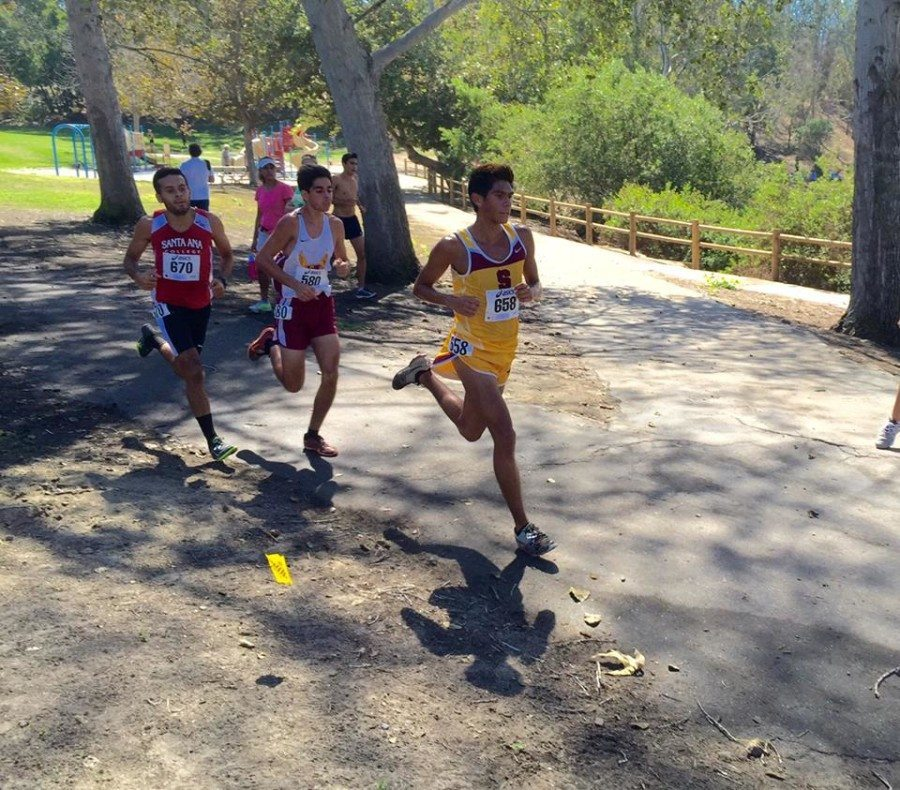 Ulysses Orozco (center) runs his way to second place at the Golden West Invitational. (Saddleback Cross-Country Facebook)