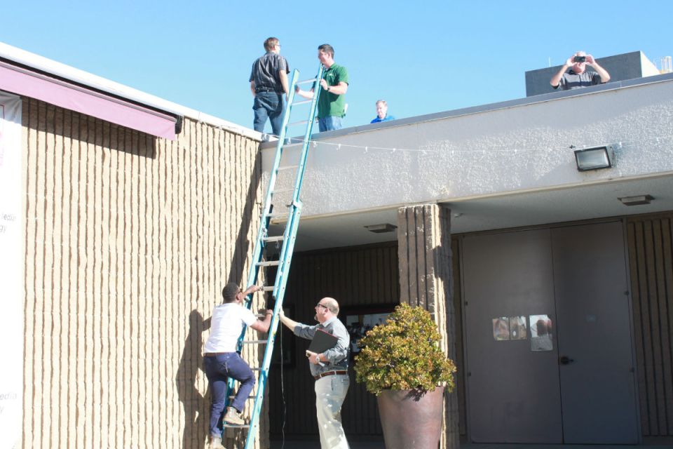 Members of Soltek Pacific Construction scope out the roof of the 300 building. Plans could be set for a renovation soon. (Jordan Rangel/Lariat)