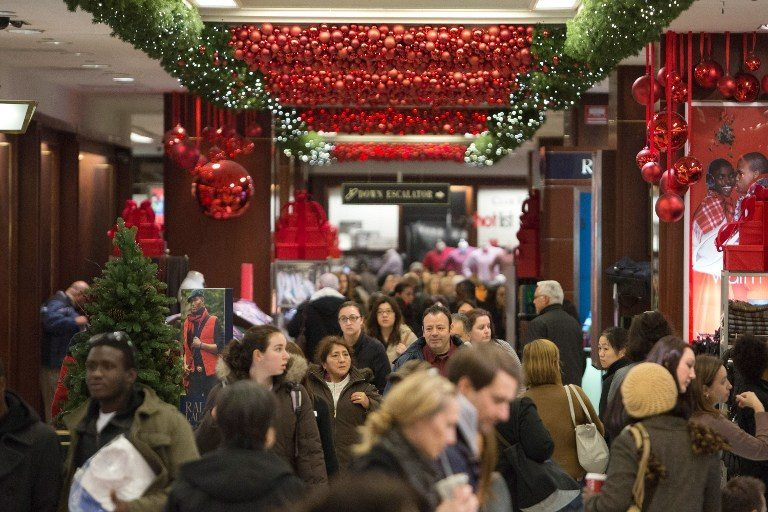 Shoppers fill Macy's during the Black Friday sales on November 23, 2012 in New York City. Black Friday, the official start of the holiday shopping season and busiest shopping day of the year for many retailers got it's name as it's said to put retailers 'in the black'. (Andrew Kelly/Getty Images/AFP)