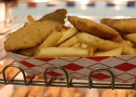 Chicken strips and fries sit under a heat lamp in the cafeteria at Saddleback College. (Betsy Johnson)