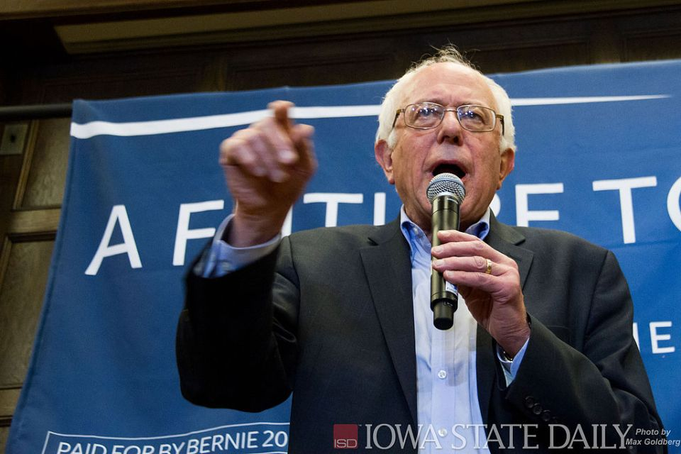 """Democratic presidential candidate Bernie Sanders speaks during a """"Canvass Launch"""" event in the Memorial Union on Jan 31, a day before the first caucus of the presidential race. Sanders spoke to a crowd of supporters and volunteers about healthcare, college debt, and global warming."""