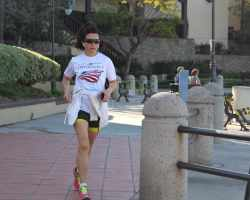 Women jogging, keeping up her physical fitness. Studies have been linked fitness to improved mental states, creating a better learning environment. (Lariat/ Austin Weatherman)