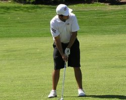 Golfer Roberto Lievana lines up his shot on the fairway. He lead his team to victory, shooting a 74. (Courtesy of Saddleback Sports Information)