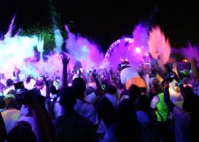 Thousands gathered in Irvine at the Verizon Amphitheatre for the Blacklight Run after party. (Angel Grady/Lariat)