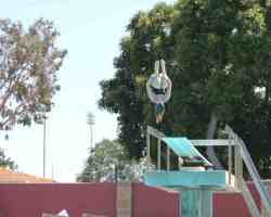 Saddleback College diver Sarah Duke getting ready for Friday's Orange Coast Conference Championship. Duke performs a somersault off the 3m diving board as part of her training. (Austin Weatherman/ Lariat)