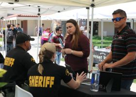 The Orange County Sheriff's Department talks with potential applicants. (Matthew Kirkland/ Lariat)