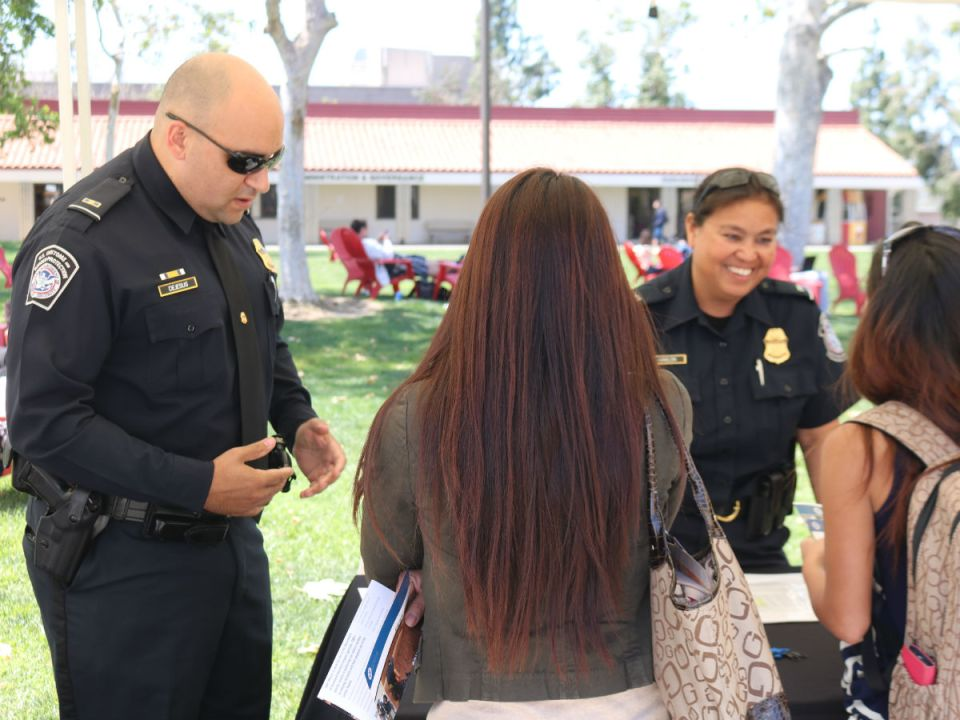 The border patrol service speaks with students at Saddleback College. (Matthew Kirkland/ Lariat)