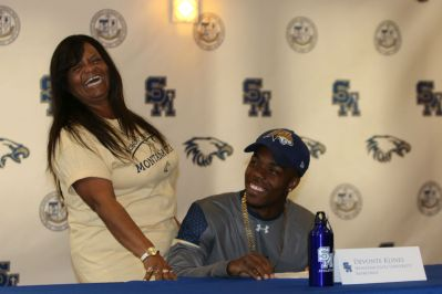 Devonte Klines with Yvette Klines, his mother as he signs with Montana State University. (Angel Grady/Lariat)