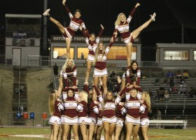 The Gauchos cheer team performs a stunt during a Saddleback home football game. (Angel Grady/Lariat)