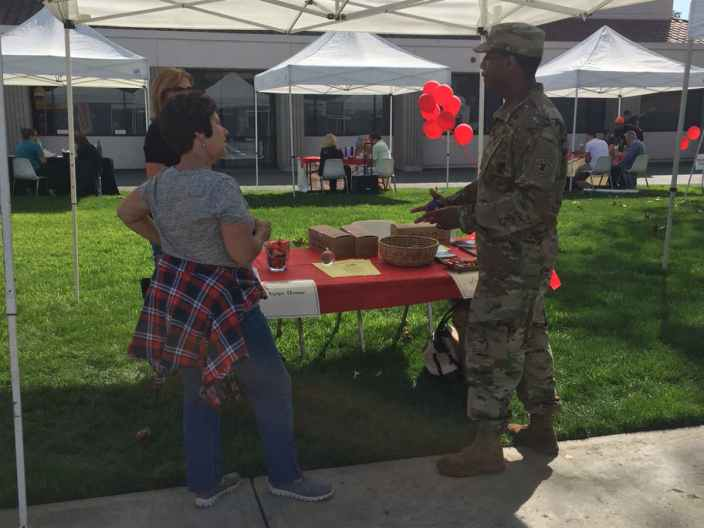 Kimberly Schaffer with AGAPE house talking to local army recruiter about students' opportunities. (Meaghan Corkill/Life Editor)
