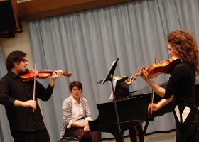 Jose Garcia Velasquez plays alongside with Canadian violinist Iryna Krechkovsky.