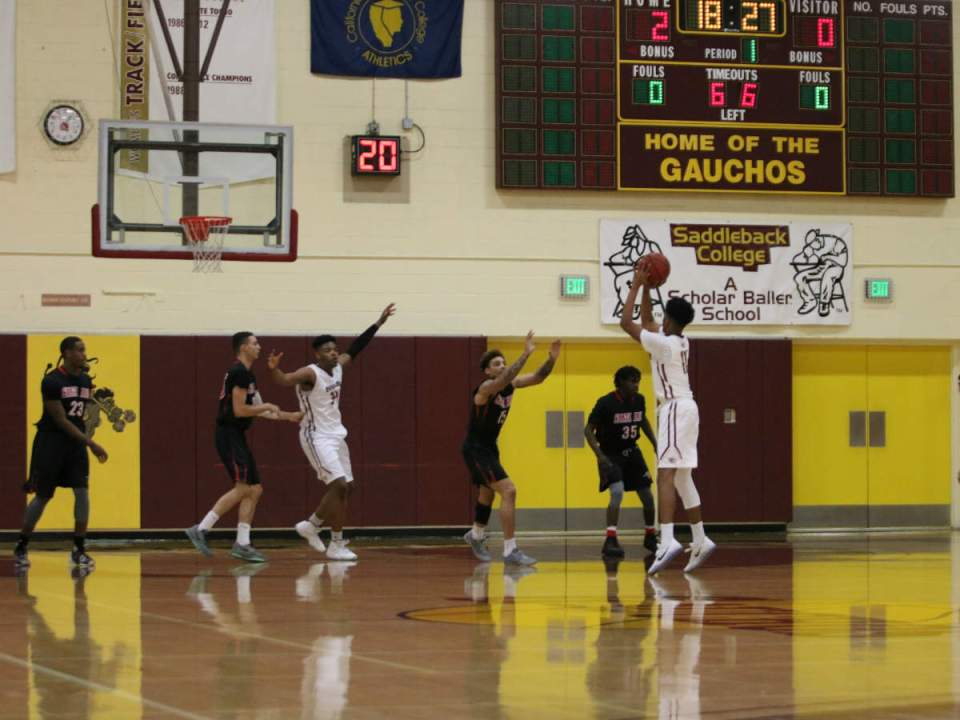 Guard Reggie Varner showing his shooting abilities from beyond the arc.
