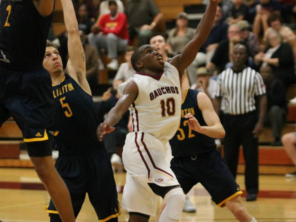 Sophomore point guard for the Saddleback College Gauchos, TJ Shorts, charges the paint and throws up an off balance runner while being swarmed by defenders during last Thursday's home loss against Fullerton College (Courtesy of Colin Reef)