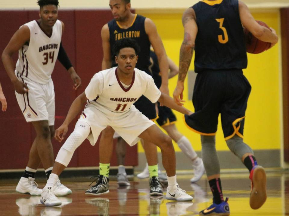 Saddleback shooting guard, Reggie Varner, gets in a defensive stance against Fullerton College point guard in Thursday's conference title loss against the Hornets (Courtesy of Colin Reef)