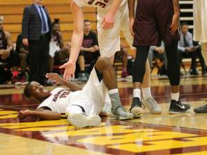 Gauchos point guard TJ Shorts gets knocked to floor after a hard foul committed by Antelope Valley College (Colin Reef/ Lariat)