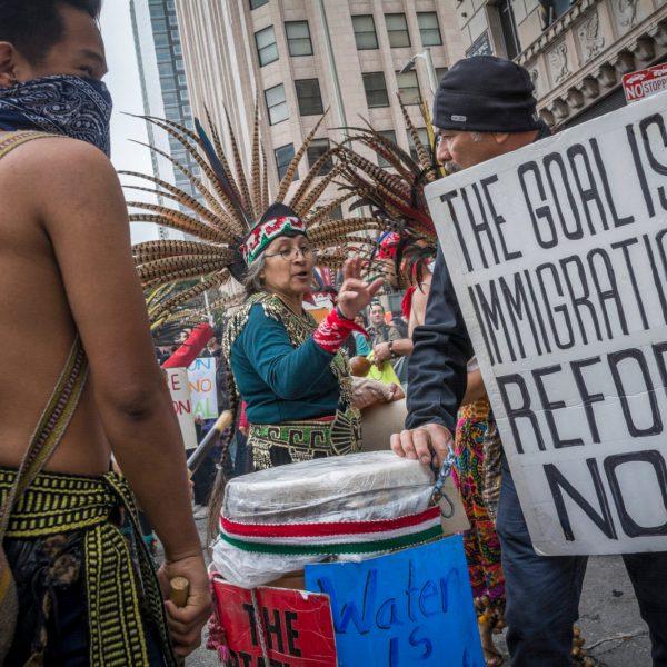 Fellow protestors expressing immigration reform. (By Jorge Maldonado)