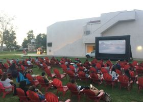 Students dig in to their popcorn as movie night begins at Saddleback College. (Joseph Fleming)