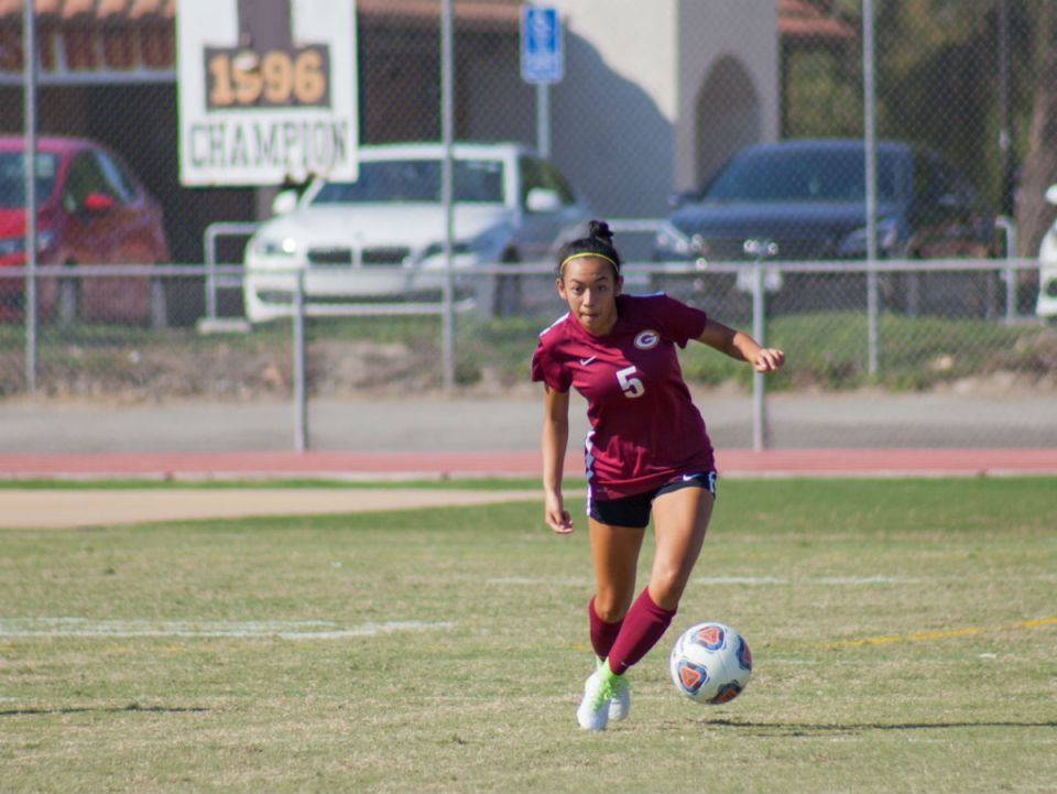 Gauchos forward Madie Bigcas tracks down a loose ball and regains momentum against the Mustangs (Ally Beckwitt/Lariat)