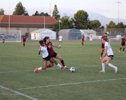 Jessica Kron battles with Golden West player for loose ball. (DJ McAllister/Lariat)