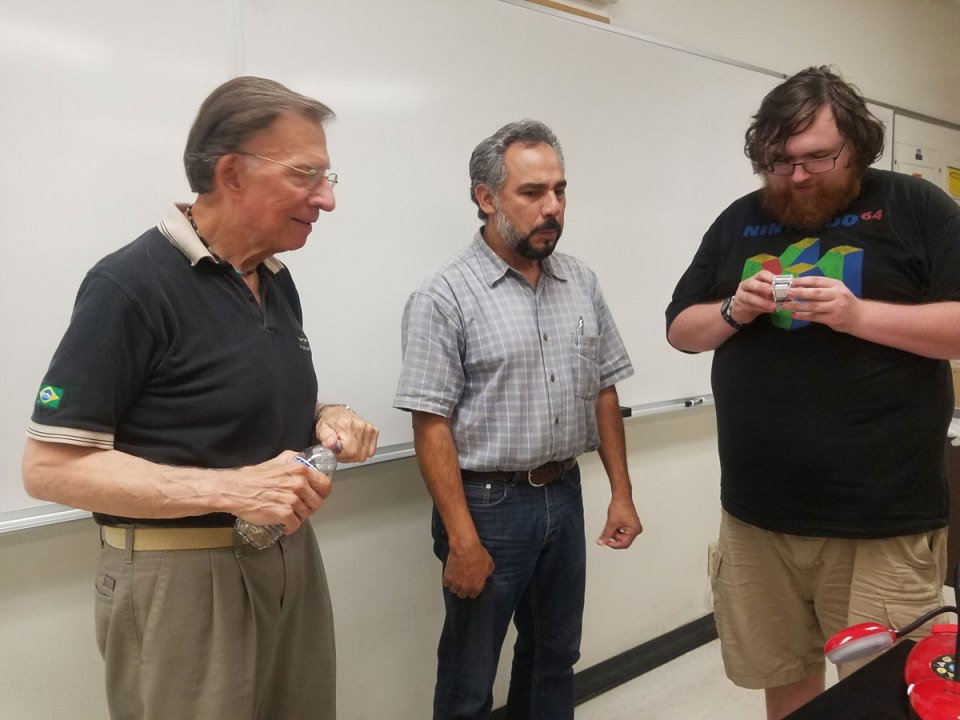 Michael Matoni, mathematics instructor Larry Perez and a student chat before Matoni's presentation last Friday at Saddleback College. (Diana Tomseth/Lariat)