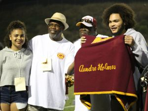 Jeff Holmes (left), Rudy Holmes and family celebrate the newly inducted hall of fame players. (Austin Weatherman/Lariat)
