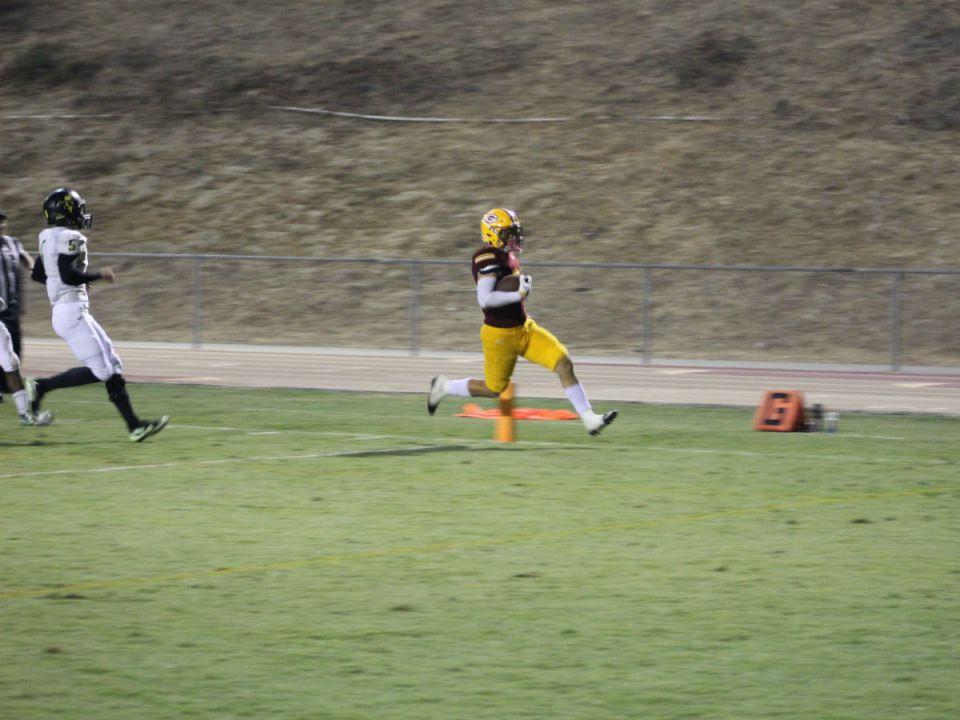 Freshman linebacker Jadon Digravio scores a touchdown for Saddleback after intercepting a Golden West pass attempt. (Austin Weatherman/Lariat)