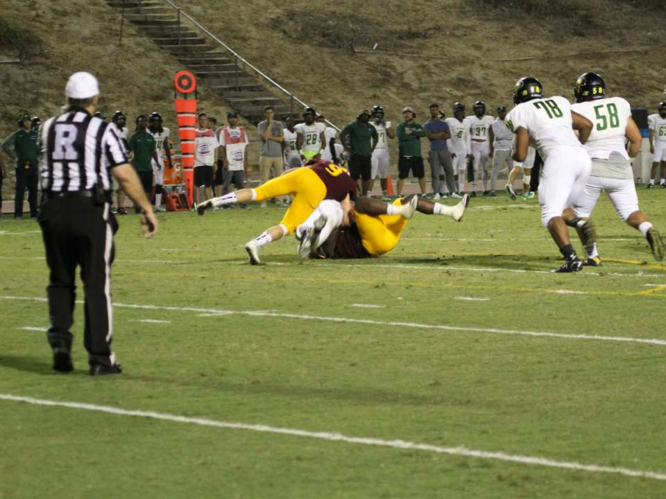 Defensive linemen Jake Hudson and Kimani Keith sack the Golden West quarterback. (Austin Weatherman/Lariat)