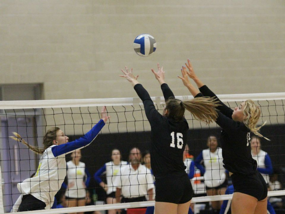 Outside hitter Kendall Nolan and middle blocker Avie Butsko put the brakes on a kill attempt from their opponent. (Colin Reef/Lariat)