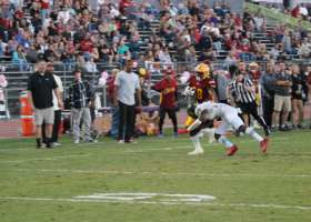 Emari Demercado fends off a Golden West College defender as he works his way down field. (Austin Weatherman/Lariat)