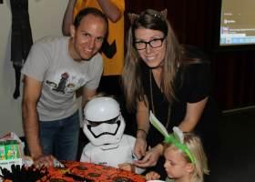 Party attendees enjoy arts crafts at Thursday's Halloween party. (Austin Weatherman/Lariat)